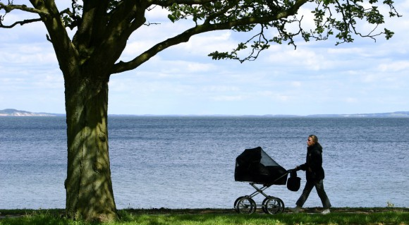woman-with-a-baby-carriage